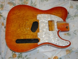 Here's the body with the pickguard in place for a humbucking pickup.