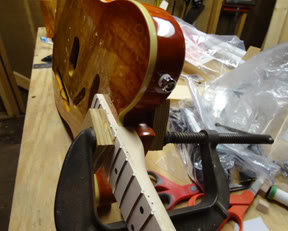 The neck is temporarily clamped to the body so I can drill the holes for the neck mounting screws in the neck.